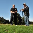 Otakou Golf Course president Alex MacGillivray and club member Kevin Charles stand on a swale of...
