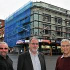 Outside Stafford House on Monday are (from left) Andrew White and Chris Willis, with former...