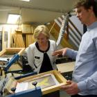 Chris Bran shows Communications Minister Amy Adams his South Dunedin screen-printing business,...