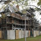 Painters continue maintenance work on the University of Otago professorial houses, north of the...