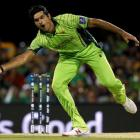 Pakistan's Mohammad Irfan stretches to field a ball while bowling against Zimbabwe. REUTERS/Jason...