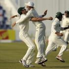 Pakistan's Umar Gul (L) embraces Younis Khan after they defeated England by 72 runs in the second...
