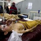 Pakistani student Liaba, front, an injured victim of an explosion, admits at a local hospital in...