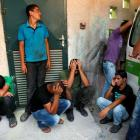 Palestinians mourn outside al-Aqsa hospital in Deir al-Balah in central Gaza Strip after an...
