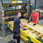 Timpack Industries workers Adam Mutch (left) and Steve Keki operate new machinery, bought by the...