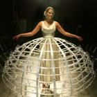Pamela Hodges models the Moet and Chandon Pomponne dress covered in 100 Champagne flutes which...