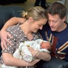Parents Nicola and Brent Prue dote over new son Angus. PHOTO: GERARD O'BRIEN