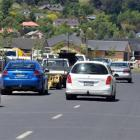 Parked cars force drivers to cross the centre line on Hagart Alexander  Dr.  Photo by Stephen...