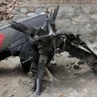 Part of a Turkish helicopter lies on the site of crash, in which 12 Turkish soldiers on board and...