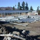 Part of the old Kurow Area School has been demolished and steel was being hoisted into place...
