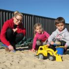 Part-time teacher Ashley Norgate, of Ranfurly, helps Isabelle Helm and Charlie Hore (both 3), of...