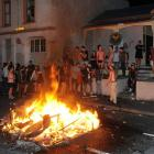 Partygoers celebrate the All Blacks' Rugby World Cup win with a fire in Hyde St, Dunedin, last...