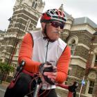 Pascal Sutherland sits on his bicycle outside the Dunedin District Court. Photo by Stephen Jaquiery.