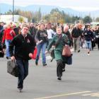 Passengers rush towards the Dunedin International Airport terminal when it was reopened after a...