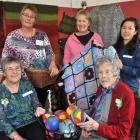 Past and present members of the Taieri Creative Fibre/Spinners and Weavers Group attend the group...