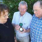 Pat Paulin (centre), of Frankton, shows a barometer to Hugh and Viv Beilby, of Auckland, that was...