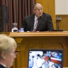 Pathologist Dr Alexander Dempster in the stand during the David Bain murder retrial in the High...