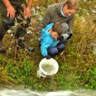 Patricia Baker and her grandson Oliver Lienert (3) liberate the first salmon smolt into the...