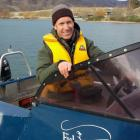 Paul van Klink undergoes boat training on Lake Dunstan yesterday, for his new role in Cromwell....