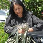 Pauline May, of Queenstown, weaves a briefcase during Waitangi Day celebrations in the Queenstown...