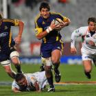 Highlanders fullback Paul Williams breaks the line with Adam Thomson in support during the game...