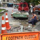 Peak Power linesman Izaac Hollegien, of Wanaka, removes cobblestones to make way for new street...