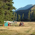 Peak time at the St Bathans domain campsite, with Central Otago's highest peak, Mt St Bathans ...