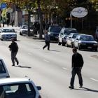 Pedestrians cross George St, near of the intersection with Albany St, just south of where an...