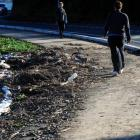 Pedestrians negotiate a storm-damaged section of the Otago Peninsula cycleway beside Portobello...