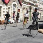 Penny-farthing racing in Oamaru's historic precinct is one of the activities which draw tourists...