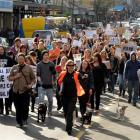People and their pets march in George St, Dunedin, yesterday in protest against recreational...