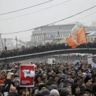 People attend a rally in Bolotnaya square to protest against violations at the parliamentary...