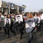 People carry portraits of local residents killed in fighting with pro-Russian separatists during...