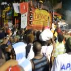 People gather after a carnival float hit power lines, on the second day of the annual Carnival...