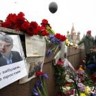 People gather at the site where Boris Nemtsov was murdered, in central Moscow, with St Basil's...