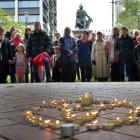 People gather in the Octagon in Dunedin yesterday to remember the victims of the terror attacks...
