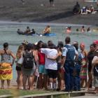 People gather opposite the footbridge from which the Raglan 16-year-old jumped. Photo: NZ Herald