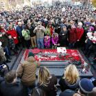 People lay poppies and other mementoes on the Tomb of the Unknown Soldier following Remembrance...