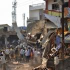 People stand near the site of an explosion in Jhabua district at Madhya Pradesh. Photo by Reuters