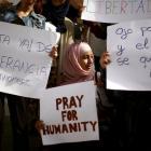 People take part in a protest against the Paris and Mali attacks in Arroyo de la Miel, near...