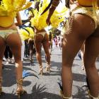 Performers dance in the street parade at the annual Notting Hill Carnival in central London....
