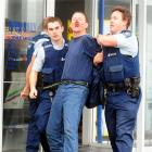 Peter John Carr is arrested at Hell's Pizza in South Dunedin on Saturday. He had escaped from the...