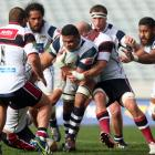 Peter Saili of Auckland is tackled during the round one ITM Cup match between Auckland and North...