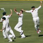 Peter Siddle (2nd R) of Australia celebrates taking the wicket of Virender Sehwag of India during...