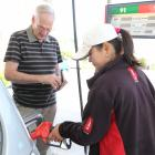 John Jillett, of Dunedin, is served by Alice Chang at Challenge Andersons Bay. Inset: Queenstown...