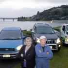 Taieri Mouth couple Helen and Ross Oldham with the three vehicles they own. Photo by Jane Dawber.