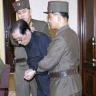 Jang Song-thaek, with his hands bound, is dragged into the court by uniformed personnel last week...