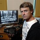 Photographer Alan Dove with his medium-format Hasselblad camera, which he used to capture the...