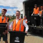 Pictured  delivering the new crates to homes in Meadowstone are (from left) delivery staff member...