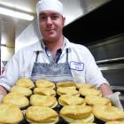 Pastry chef Bernard Kirkpatrick, of Roxburgh, takes another tray of pies out of the oven at Jimmy...